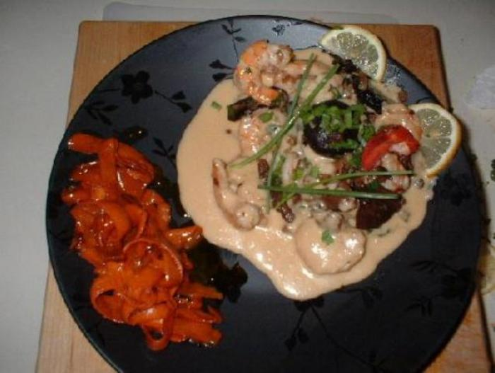lobster, shrimps and mushrooms in rosemary veloute